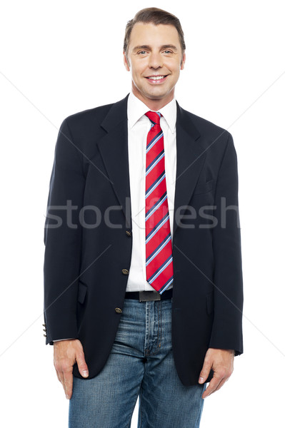 Smiling young businessperson posing casually Stock photo © stockyimages