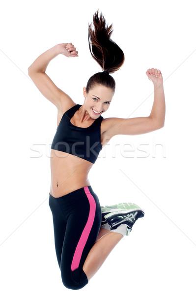 Młoda dziewczyna odzież sportowa skoki radości dziewczyna Zdjęcia stock © stockyimages