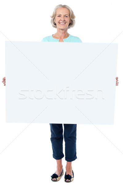 случайный старушку Billboard счастливым Сток-фото © stockyimages