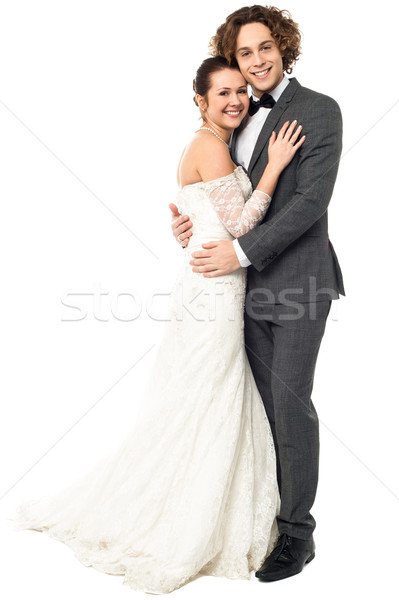 Lovely young married couple embracing Stock photo © stockyimages