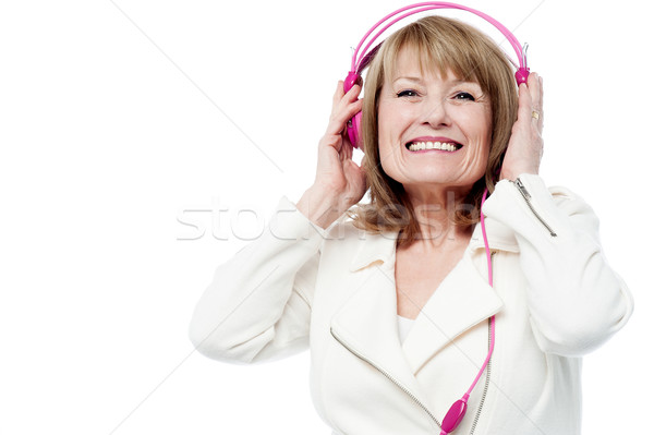 Pretty lady enjoying rock music Stock photo © stockyimages