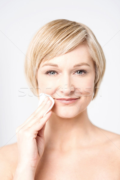 Almost my make up is complete. Stock photo © stockyimages