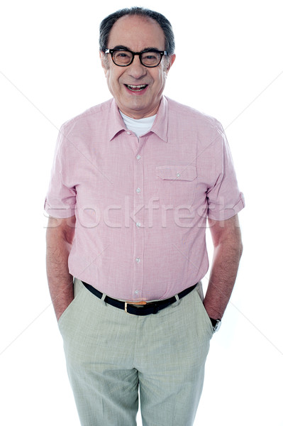 Smiling casual senior man with hands in pocket Stock photo © stockyimages