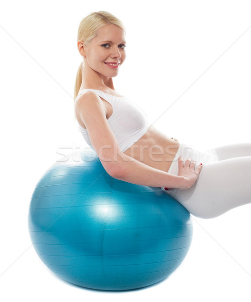 Beautiful teenage girl back stretch over exercise ball Stock photo © stockyimages