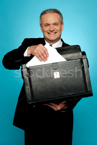 Businessman keeping documents safely Stock photo © stockyimages