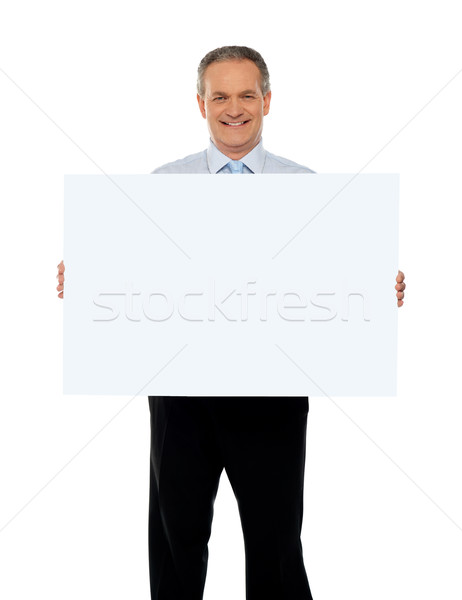 Stock photo: Experienced male representative with ad board