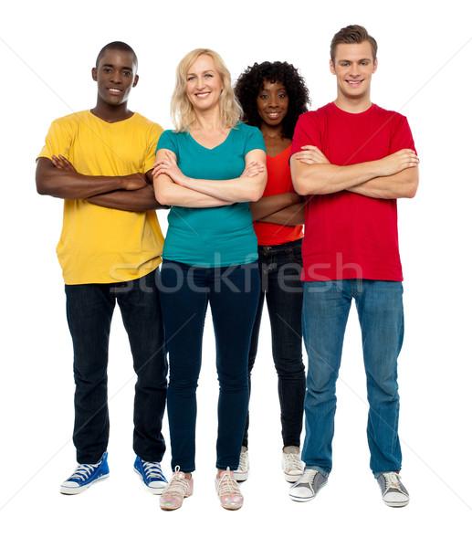 Csapat fiatalok pózol stílus áll kezek Stock fotó © stockyimages