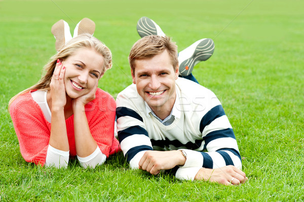 Happy young couple outdoors Stock photo © stockyimages