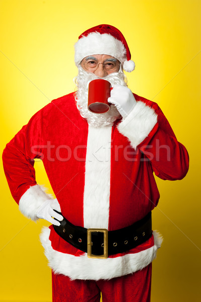 Portrait of a aged Santa sipping coffee Stock photo © stockyimages