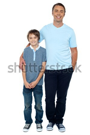Casual studio shot of father and son Stock photo © stockyimages