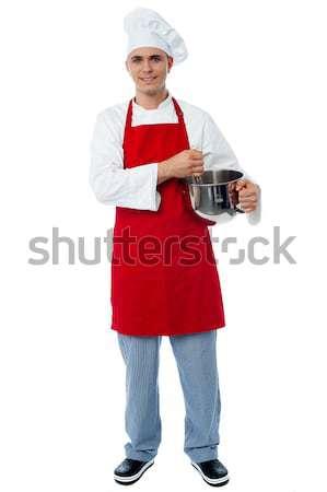 Geïsoleerd jonge mannelijke chef poseren geschoold Stockfoto © stockyimages