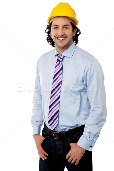 Young male engineer posing casually Stock photo © stockyimages