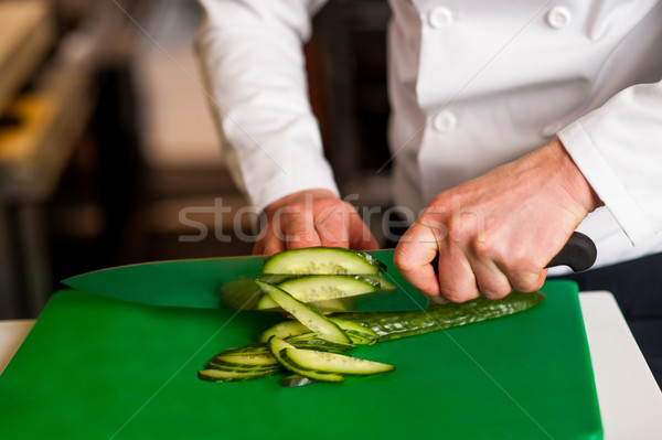 Chef chopping leek over green carving board Stock photo © stockyimages