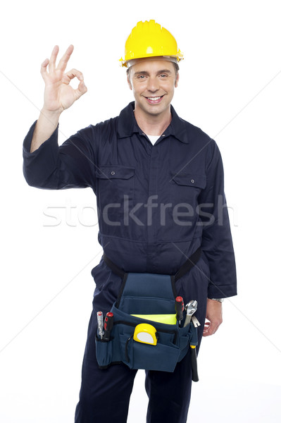Senior repairman showing good work done sign Stock photo © stockyimages