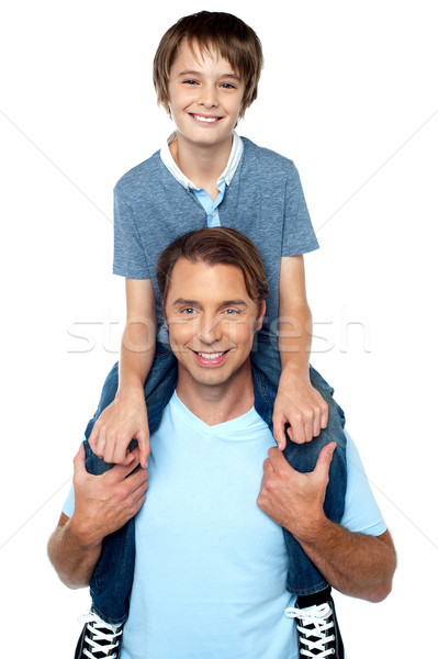 Imádnivaló fiatal fiú élvezi háton derűs Stock fotó © stockyimages