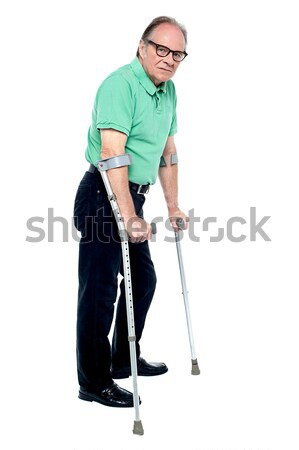 Mozgássérült idős férfi mankók sétál segítség néz Stock fotó © stockyimages