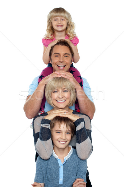 Young lovable happy family Stock photo © stockyimages