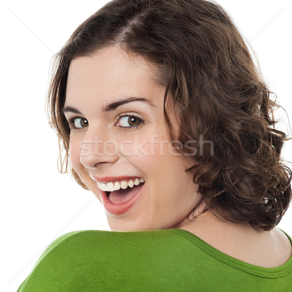 Excited caucasian woman looking at you Stock photo © stockyimages