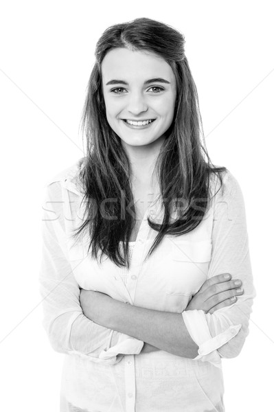 Black and white image of a confident smiling girl Stock photo © stockyimages