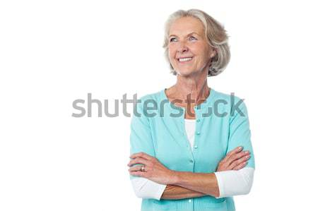 Old lady in casual wear looking away Stock photo © stockyimages