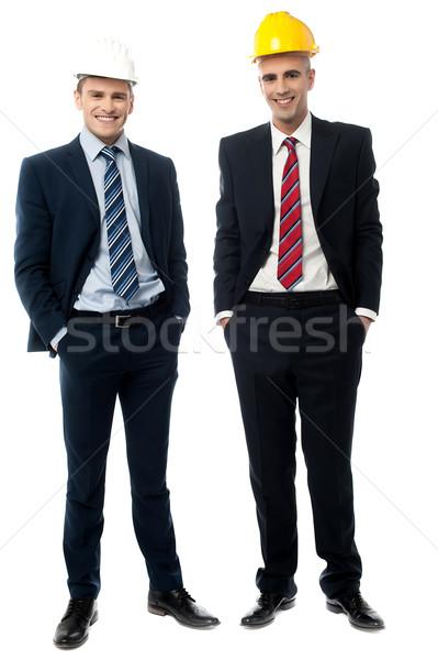 Burgerlijk ingenieurs poseren zakenlieden witte Stockfoto © stockyimages