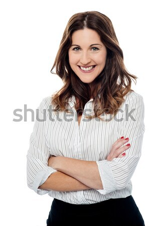 Beautiful female in casuals, arms crossed Stock photo © stockyimages