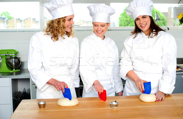 Professional chefs kneading bread dough Stock photo © stockyimages