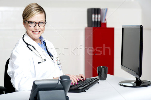 Female physician using computer Stock photo © stockyimages