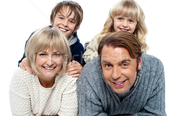 Spirited kids having fun with their parents indoors Stock photo © stockyimages