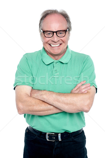 Studio shot of a cheerful elderly man Stock photo © stockyimages