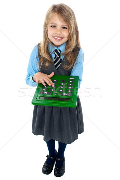 довольно ребенка школьную форму калькулятор школьница Сток-фото © stockyimages