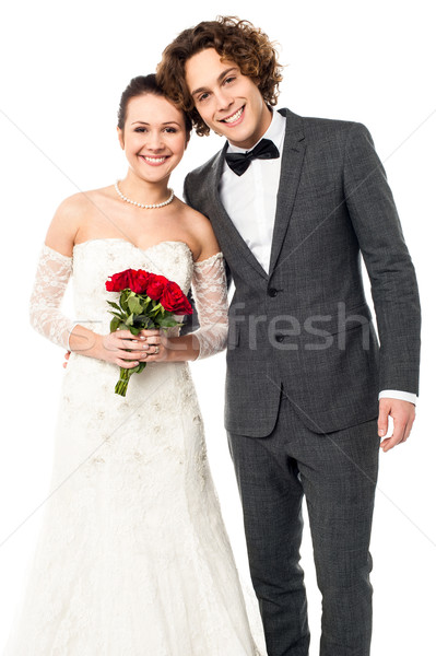 Lovely newlywed couple posing for a portrait Stock photo © stockyimages