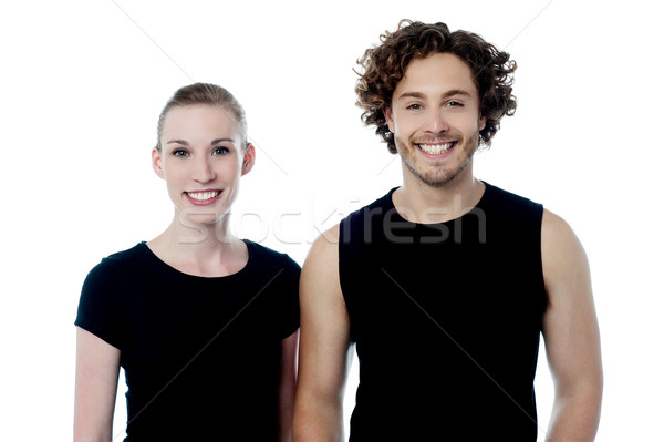 Smiling young couple in casuals Stock photo © stockyimages