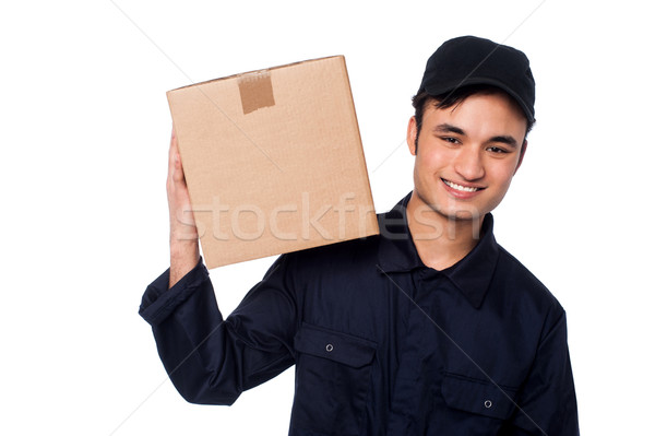 Smart courier boy with parcel on shoulders Stock photo © stockyimages