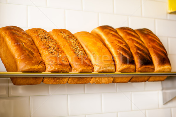Freshly kneaded grain and white breads for sale Stock photo © stockyimages