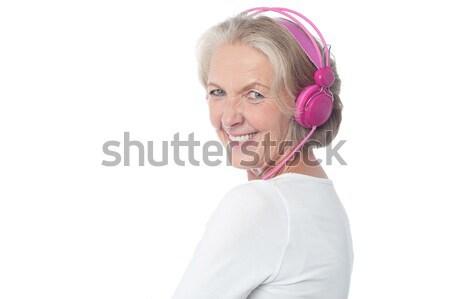 ストックフォト: 女性 · 音楽 · 幸せ · 歳の女性