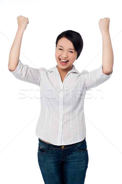 Excited charming girl with clenched fists Stock photo © stockyimages