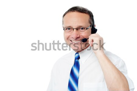 Mature business execuitve with headset Stock photo © stockyimages