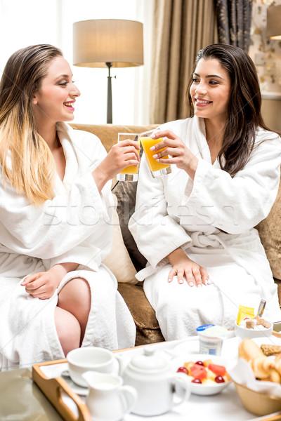 Celebrar ocasião dois belo feminino amigos Foto stock © stockyimages