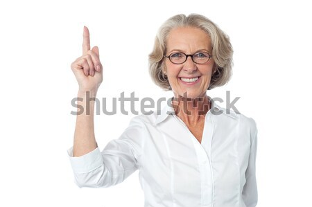 Old lady showing excellent gesture Stock photo © stockyimages