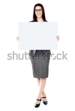 Portrait of a business lady holding a blank billboard Stock photo © stockyimages