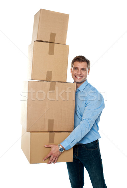 Smiling male holding stack of cartons Stock photo © stockyimages