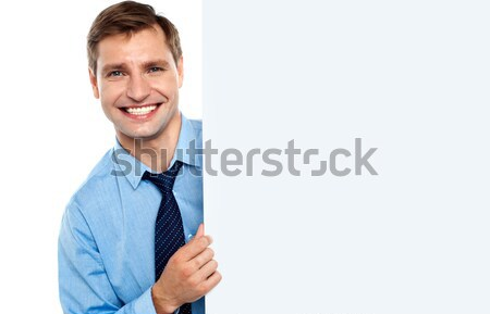 Business man holding a long blank banner ad Stock photo © stockyimages
