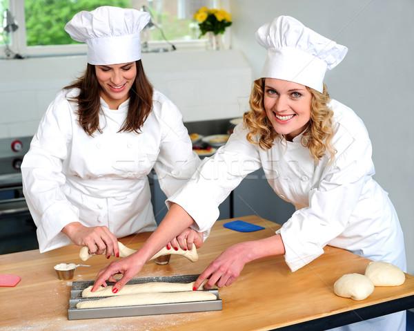 женщины повар подготовленный другой долго Сток-фото © stockyimages