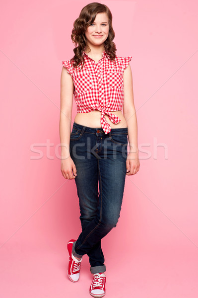 Pretty teenager standing with crossed legs Stock photo © stockyimages
