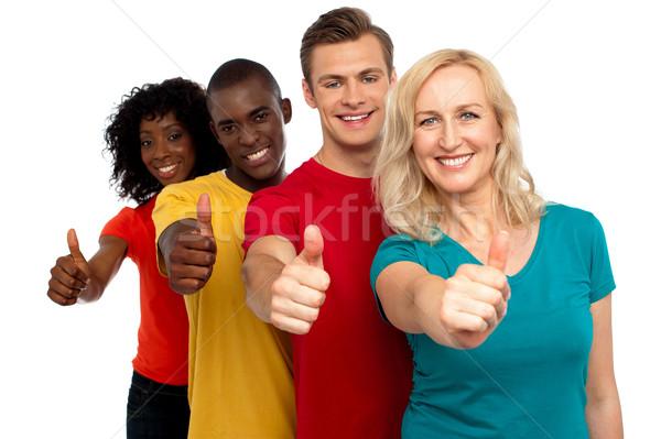 Gülen grup insanlar jest Stok fotoğraf © stockyimages