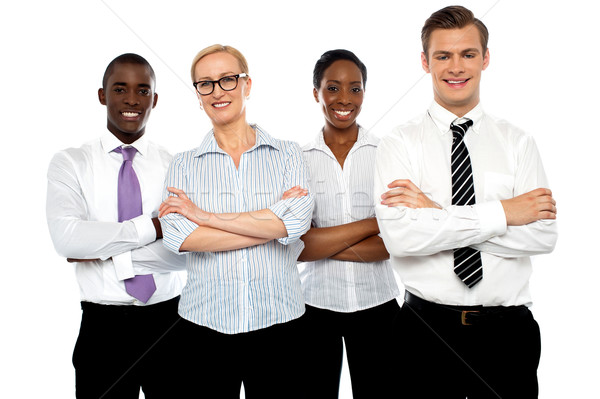Group of business people posing with arms crossed Stock photo © stockyimages