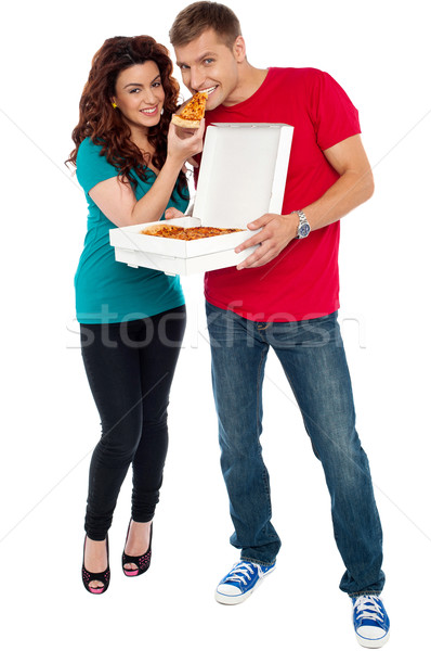 Couple enjoying pizza together, great bonding Stock photo © stockyimages