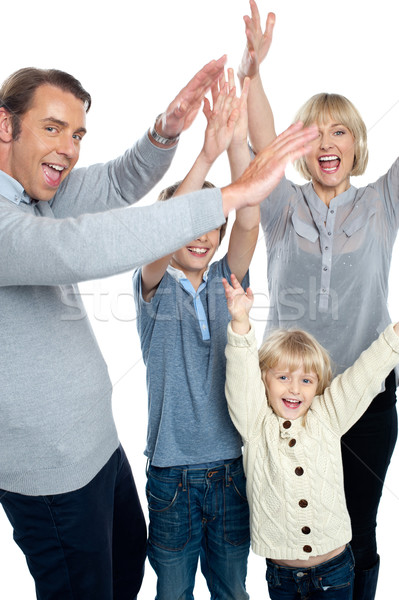 Jubilant family celebrating and partying indoors Stock photo © stockyimages