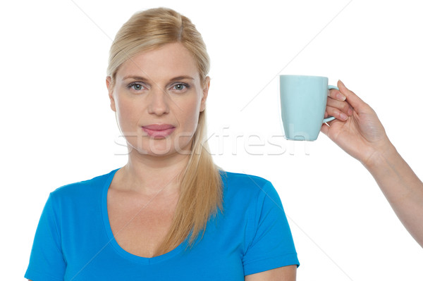 Woman is being offered a cup of beverage Stock photo © stockyimages